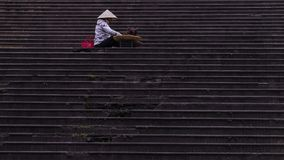 On the stairs. A woman selling fruits at Dalat market, Vietnam Royalty Free Stock Photos