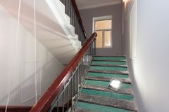 Stairs with wooden banisters is the part of interior of apartment during upgrade or remodeling, renovation, extension, restorat. Ion, reconstruction and royalty free stock images
