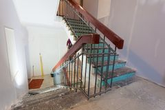 Stairs with wooden banisters is the part of interior of apartment during upgrade or remodeling, renovation, extension, restorat. Ion, reconstruction and royalty free stock photo