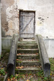 Stairs and wooden door in a wall Stock Image