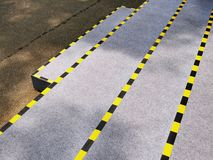 Stairs with Yellow and Black Striped Tapes for Safety Caution. High Angle View of Stairs with Yellow and Black Striped Tapes for Safety Caution stock photos