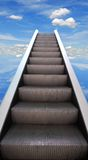 Stairway. Escalator stairway to success on blue sky background Royalty Free Stock Images