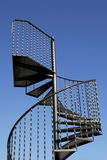 Stairway. Steel Spiral Staircase against a clear blue sky Royalty Free Stock Image