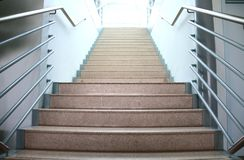 Stairway. A modern stairway leeding up to the hall Stock Photos
