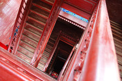 Stairway. Vintage wooden narrow red stairway shown from the top Stock Image