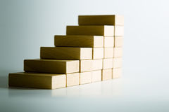 Stairway. Conceptual stairway of wooden blocks. focus in the center Royalty Free Stock Photo