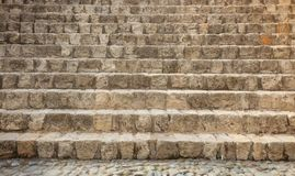 Stairway aged, weathered made from stones. Empty stonework background, close up view with details. Stairway aged, weathered made from stones. Blank stonework Royalty Free Stock Images