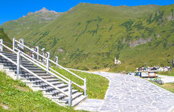 Stairway along an alpine path. View of a stairway along the mountain train,alps Royalty Free Stock Photos