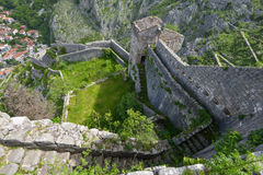 The stairway along the walls of Fortress of Kotor. The stairway along the walls in the fortress of Kotor, Montenegro with Kotor beneath Stock Image