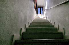 Stairway and bright window Stock Photography