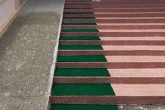 Stairway with carpet and Slope down walk way Royalty Free Stock Photography