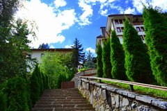 Stairway climbing hill. Stairway climbing to new hotel perched on hilltop at Bulgarian Rhodopes mountains, Shiroka laka village Royalty Free Stock Images