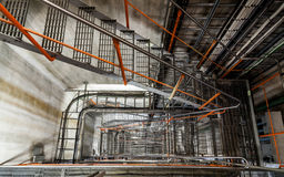 Stairway in a decommissioned power plant. Cables, pipes Royalty Free Stock Photography