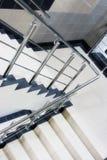 Stairway enclosure with metallic stair Royalty Free Stock Image