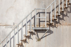 The stairway on exterior of refinery industrial storage tank. Royalty Free Stock Photo