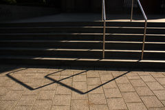 Stairway with handrail. Light and shadow. Royalty Free Stock Photography