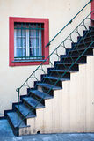 Stairway, Iron Railing and Red-Framed Window Stock Images