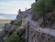 Stairway leading to a chapel. The road leading to the chapel Notre-Dame de Beauvoir in the French town of Moustiers-Sainte-Marie royalty free stock photos