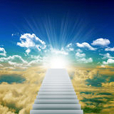 Stairway leading up to bright light Royalty Free Stock Images