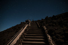 Stairway leading up to the night sky. Concrete stairway leading up to the night sky on Mount Haleakalā, in Maui, Hawaii Royalty Free Stock Photography