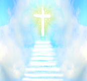 Stairway leads to cross and glowing light Royalty Free Stock Photography