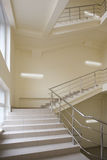 Stairway with metal handrails. In the new modern building Royalty Free Stock Photo