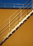 Stairway. Metallic stairway on yellow house Stock Photo