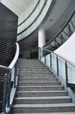 Stairway in modern building. Stairs with glass guardrail in a modern building Stock Photography