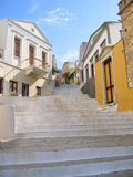 Stairway in old greek city. Steps of alleyway leading upwards Symi Greece Stock Image
