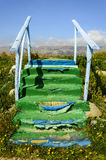 Stairway. Old steps colorful, blue sky and mountains Stock Photos