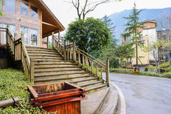 Stairway of roadside wooden building after rain Stock Image