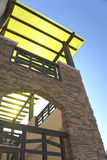 Stairway and Roof. With a blazing sun and blue skies in the background Stock Photo