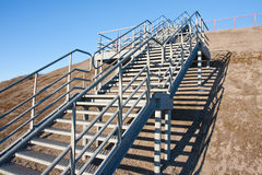 Stairway of stainless steel to the blue sky. Modern stairway of stainless steel to the blue sky Royalty Free Stock Photo