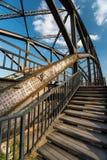 Stairway at steel railroadbridge Stock Photos