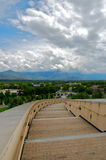 Stairway to... From the top of the main library in Salt Lake City, Utah, a stairway curves toward a view of the mountain ranges and open sky Stock Photos