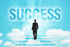 Stairway to business Success. Businessman walking on a stairway to SUCCESS over the bright blue sky Royalty Free Stock Image