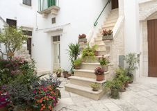 Stairway to entrance home in Locorotondo, southern Italy. Pictured is a stairway to the entrance of a home in Locorotondo.  It is decorated with lovely small Stock Images
