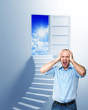 Stairway to the freedom. Stressed man and stair to solution Stock Photo
