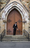 Stairway To Heaven. Well Dressed Man Standing At The Entrance Of A Church Door As This Is His Stairway Into Heaven Royalty Free Stock Image