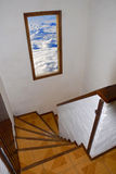 Stairway to heaven. Staircase with open window to a cloudy sky Royalty Free Stock Photography