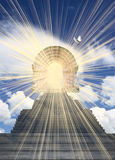 Stairway to heaven. Stairways leading to clouds in the sky and a radiant doorway symbolizing heaven Stock Photography