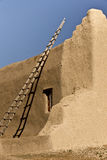 Stairway to Heaven. A wooden ladder against an adobe wall of a rural Spanish colonial church in near Taos New Mexico royalty free stock photo