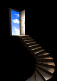Stairway to Heaven. Open door with stairs and a blue sky with clouds Royalty Free Stock Images