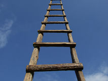 Stairway to Heaven. A long wooden ladder to the blue sky Stock Photos