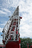Fire ladder. The fire ladder lifted highly in the sky Royalty Free Stock Photography