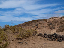 Stairway to heaven. Stairway and blue sky on the sandy beach of Fuerteventura Royalty Free Stock Photo