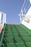 Stairway to heaven. Green metal stairs on a ferry boat Royalty Free Stock Image