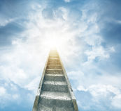 Stairway to heaven. Stairway leading up to bright light Stock Photo