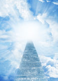 Stairway to heaven. Stairway leading up to bright light Stock Photography