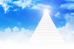 Stairway To Heaven. Stairway leading up to bright light above the sky Royalty Free Stock Images